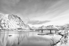 A kingdom of isolation (OR_U) Tags: 2017 oru norway lofoten gimsøya winter sea ocean sund island mountain sunset bw blackandwhite blackwhite schwarzweiss landscape seascape bridge e10 sky clouds serenity