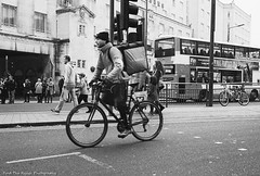 Cyclist (Rich Presswood) Tags: leicam6 kodaktrix leitz voigtlander35mmf17ultron street urban film analogue availablelight bw blackandwhite black white findtherangephotography decisivemoment cyclist bike man contrast city cityscape grain leeds streetphotography