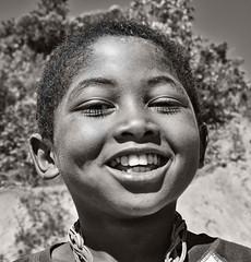 Malagasy Boy (Rod Waddington) Tags: africa afrique madagascar malagasy boy child outdoor blackandwhite portrait people culture candid smile roadside
