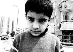 Silver. (2) (osmanstto) Tags: photography portrait people child childhood boy young youngboy youngchild town silver streetphotography street streetphoto buildings alone sad lonely egypt everydayegypt everydayeverywhere explore africa hope hopeless thisisegpyt thisisegypt photoshopraw raw rawimages shotwithcanon canon bw blackandwhite