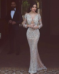 Heavily beaded evening gowns like this don't have to cost a fortune. Our dress design firm is located near Dallas Texas and can make elegant beaded #eveningdresses for a very reasonable price. In addition to custom designs we also can make #replicadresses