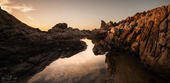 Hidden Between The Rocks (Bryn De Kocks) Tags: sunset reflection beach water landscape southafrica coast rocks cape sigma1020mm canon50d