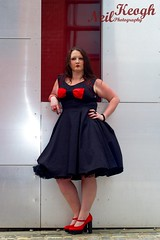 IMG_4505 (Neil Canon Keogh) Tags: red black vintage necklace highheels dress retro ring redhead bow buskers bracelet heels rockband pinup pinupgirl trianglesquare manchestercitycenter dressmodellaura