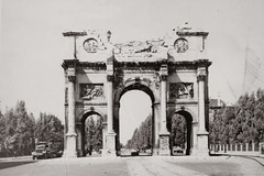 1945 World War II snapshot of the damaged Siegestor (Victory Gate) in Munich, Germany - Commissioned by King Ludwig I of Bavaria, the Siegestor was designed by Friedrich von Gartner and constructed between 1843 and 1852. Situated at the terminus of the Lu (thstrand) Tags: city urban history architecture germany munich bavaria ruins europe european destruction wwii snapshot cities arches nobody landmark worldwarii 1940s german snapshots triumphalarch trucks munchen wars damaged 20thcentury 1945 destroyed bombed worldwar2 bavarian siegestor secondworldwar militaryvehicles urbanscene historicphoto statechancellery bombdamage historicalphotograph 19thcenturyarchitecture victorygate kingludwigi builtstructure builtstructures friedrichvongartner