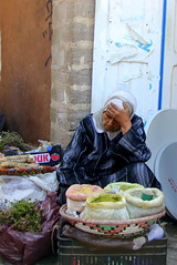 Waiting for a sale (fuzzball5) Tags: woman spice morocco souk essaouira