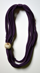 calza viola e bottone della mamma del Maslè