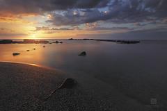 Eye on The Beach (Sakhr Abdullah) Tags: sunset sea sunlight seascape beach clouds coast sand rays jeddah