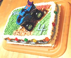 "Grandson ""Miles"" 4th birthday cake. Dinosaur ready to bite the truck must be added still. (polepenhollow) Tags: cake birthdaycake monstertruck 4yearsold"