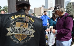 "This member of the ""Black Sheep - Harley Davidsons For Christ"" was among the crowd lined up for a free lunch being served by two church groups in Denver. (desrowVISUALS.com) Tags: economics economy poverty poorpeople austerity poor"