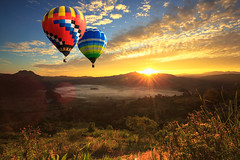 Colorful hot air balloon is flying at sunrise (Krunja) Tags: adventure aerial air aircraft background balloon ballooning balloons beautiful blue bright clouds color colorado colorful flight floating fly flying free freedom fun high hot hotair journey landscape morning mountain nature outdoor over recreation ride romantic scenic sky sport summer sunny sunrise sunset tourism transportation travel up vacation valley view
