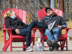 Sunny disposition (BruceK) Tags: harbourfront toronto chairs red couple sunshine spring candid laughter