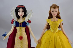 Limited Edition Snow White Doll Welcomes LA Ball Gown Belle - Midrange Front View (drj1828) Tags: disneystore limitededition 17inch snowwhite belle ballgown yellow 2009 2017 groupphoto purchase welcome