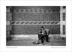 Rijksmuseum musician (ekkiPics) Tags: amsterdam flickrmeet theglobalcamelcommittee rijksmuseum musician accordion bach streetmusic
