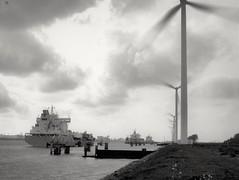 Windmills and ships (Giel Pieter) Tags: windmills rotjeknor rotterdam portofrotterdam ship water harbour energy sky