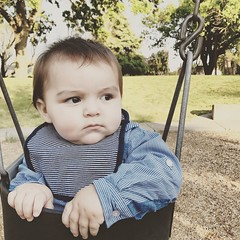 First time in a swing. (Mr.Machain) Tags: lodilake playground bark grass trees california lodicalifornia lodi park outside outdoor outdoors swing baby kid child