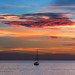 Sunset with lonely yacht