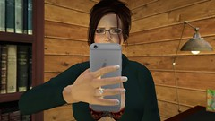Social Media Anxiety (alexandriabrangwin) Tags: alexandriabrangwin secondlife 3d cgi computer graphics virtual world photography home corner house wood panel log cabin desk lmap mobile phone cell worried holding anxiety social media fear people
