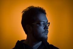 Self portrait (TAmovieman) Tags: me self portrait orange teal blue black color gel glasses background
