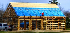 Starting the Roofing on a Timber Frame in La Coulee, Manitoba (ezigarlick) Tags: roofing building construction timberframe timbers lacoulee manitoba rmofsteanne steannerm