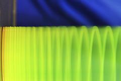 motion blur. (maotaola) Tags: macromondays intentionalblur motionblur pull blur greenblur macrophotography macro movement slinky toy muelleloco camerablur