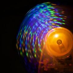 Rainbow Fan (phil_1_9_7_9) Tags: explored onexplore explore macromondays intentionalblur macro nikond700 afzoomnikkor3570mmf28d blur hmm square orange rainbow colours colors shiny fan spinning 35mm