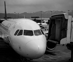 Delta parked at SLC (clint mcmahon) Tags: travel blackandwhite mountains canon airplane airport gate waiting parking jet delta saltlakecity slc airports dl pilot pilots deltaairlines t4i canonefs18135mmf3556isstm