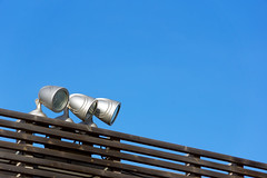 Spotlights (Mikel Martnez de Osaba) Tags: wood blue light sky lamp electric metal bulb modern outdoors lights wooden energy power bright projectors metallic gray lightbulbs spot spotlight lamppost electricity lamps lightning electrical spotlights outsie