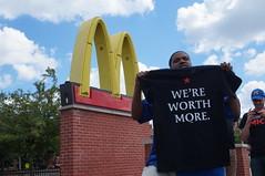 New Striking Worker Proudly Displays Shirt (Light Brigading) Tags: wisconsin union 15 mcdonalds milwaukee kfc strike minimumwage fastfoodstrike raiseupmke lowwageworkerstrike raiseupmilwaukee 15andaunion
