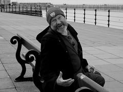 Bencher! (Raymond Paul - SP) Tags: people blackandwhite mono seaside candid streetportrait fujifilm urbanstreetphotography wirral newbrighton streetshot urbanlife merseyside urbanstreets citybythesea streetphotographyliverpool fujix20