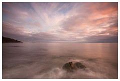 Greystones Dawn (Ashley Lowry) Tags: ocean morning pink blue ireland light sea sky howth irish seascape beach water rock stone clouds strand sunrise landscape flow dawn coast waves greystones boulder wash land wicklow milky wispy daybreak ebb