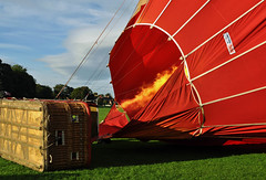 The final push.... (littlestschnauzer) Tags: york trip travel red sky hot its fire nikon basket air side flames balloon flight silk adventure virgin elements heat canopy racecourse lay inflation inflating d5000