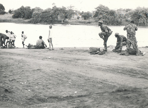 Moz govt forces about to cross a flooded bridge in Moz somewhere (1971)