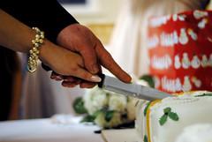 (MegsPhotosUK) Tags: flowers wedding food cake 50mm groom bride hands hand cut knife holly celebration eat nails foodporn bracelet cutting cuttingthecake