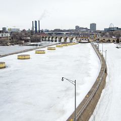 Saint Anthony Falls  Ice (Van Allen Belt) Tags: pen river mississippi lumix minneapolis olympus falls panasonic 20mm ep2 stanthony stonearchbridge saintanthony