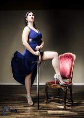 Wonder Women - Sabreena (3) (FightGuy Photography) Tags: sabreena studiob union206 wonderwomen dress studio sword weapon blade bluedress brunette amazon heels chair motion broadsword longsword