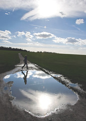 With an apology.  Epsom Down, Surrey (MJ Reilly) Tags: epsom eposmdowns uk england nikon d90 countryside english reflection reflect sun path puddle dogwalker passerby walking lady woman spring
