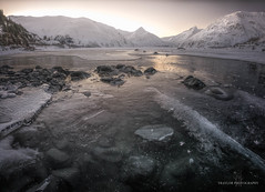 Peaceful stillness (Traylor Photography) Tags: alaska current sunrise opacity whittier mountains snow morning portagelake rocks begichboggsvisitorcenter march portagevalley placerriver subzero winter reflection cracks anchorage portageglacier frozen ice unitedstates us