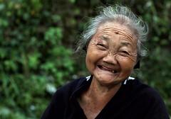Joss Stick Seller (cowyeow) Tags: liannan guangdong asia asian china chinese portrait old liannanyaovillage yao village minority minoritygroup travel rural composition 连南 culture matriarch lady oldlady woman oldwoman funny women smile wrinkles mole