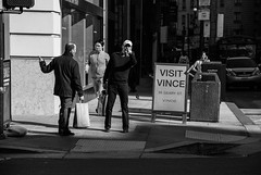 not vince (Super G) Tags: nikon172 streetphotography blackandwhite man men pointing shadows woman cellphone vince geary sanfrancisco wheredidvincego hewashereaminuteago ithinkhesoverthere nohesoverthere