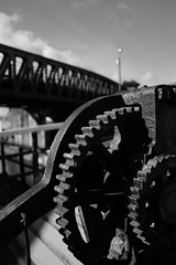 Canal gears (Lucky Poet) Tags: bowling forthandclydecanal scotland westdunbartonshire bascule blackwhite bridge cogs detail gears harbour machinery monochrome