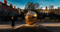 Golden Orb (David Ramalho) Tags: gold woman sky spring reflection sphere sculpture art street streetphotography dublin tcd