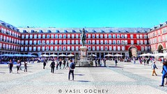 Plaza Mayor (Vasil Gochev) Tags: plaza mayor main square originally del arrabal central city madrid spain renowned classical architecture spanish tour tourist tourism travel traveler photography buildings monument sculpture sun sky people felipeiii statuate casa de la panadería