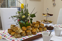 Mid Morning Feast (Proinsias Ó Foghlú) Tags: scones cakes jam brack tea coffeeflowers easter eggs buns cups saucers napkins white tablecloth tralee kerry ireland