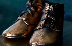 Baby Steps (johnsinclair8888) Tags: explore macro macromondays glaze johndavis nikon sigma art shoes babyshoes bronze bokeh gold