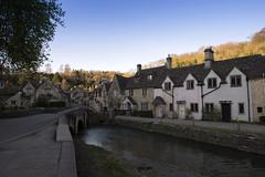 Castle Combe (Roger.C) Tags: village beautiful beauty picturesque cottages river castlecombe wiltshire wilts cotswolds stone bridge bluesky sun westcountry southwest historic history nikon d610 tamron 2470 scenery scenic daysout tourism