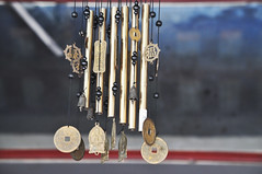 Melodic sounds (Roving I) Tags: windchimes restaurants decor design beads metal pipes danang vertical vietnam