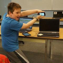 "Sam presents his ""Rock, Paper, Scissors"" app to the class (Pima County Public Library) Tags: boy smile computer person stem phone tech creative class teen android app createit pcplphotolibrary"