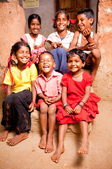 Group of Cheerful Rural Indian Children (Charlotte L. Sanchez) Tags: door family blue friends portrait people india love smiling vertical horizontal asian fun outdoors wooden clothing village child friendship affection indian joy happiness simplicity innocence littlegirl cousin casual maharashtra brightcolors sibling cheerful groupofpeople bonding littleboys ruralscene 45years childrenonly 810years 1213years preadolescentchild primaryagechild mediumgroupofpeople sixpersons