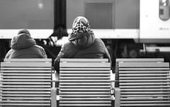 Banc (jb.faure) Tags: people blackandwhite bw white black germany 50mm back streetphotography trainstation freiburg badenwrttemberg