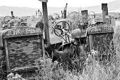 Lost John Deere Tractors (Rebekahdg) Tags: travel blackandwhite abandoned oregon outdoors condemned decay country decrepit johndeere countrylife whiteandblack travelphotography easternoregon canonphotography outdoorphotography
